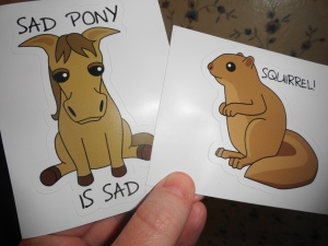 Goldfish even made Sad Pony and Squirrel stickers in her Redbubble Shop! You can also get them on a photo (I have them hanging up), or a pillow, or a baby onesie. Provided she still has it up? I don't know. But it's awesome!
