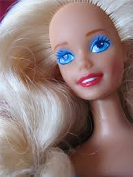 "At one point one of the Barbies exclaimed ""It worked!  She's getting pimples!""  Ah, justice."