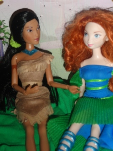 Pocahontas: Alice spends too much. Merida: Yes, but maybe she'll buy you that hunky boyfriend.