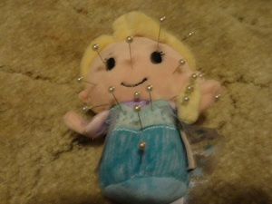An Elsa voodoo doll? (I did not put her up to this one.)